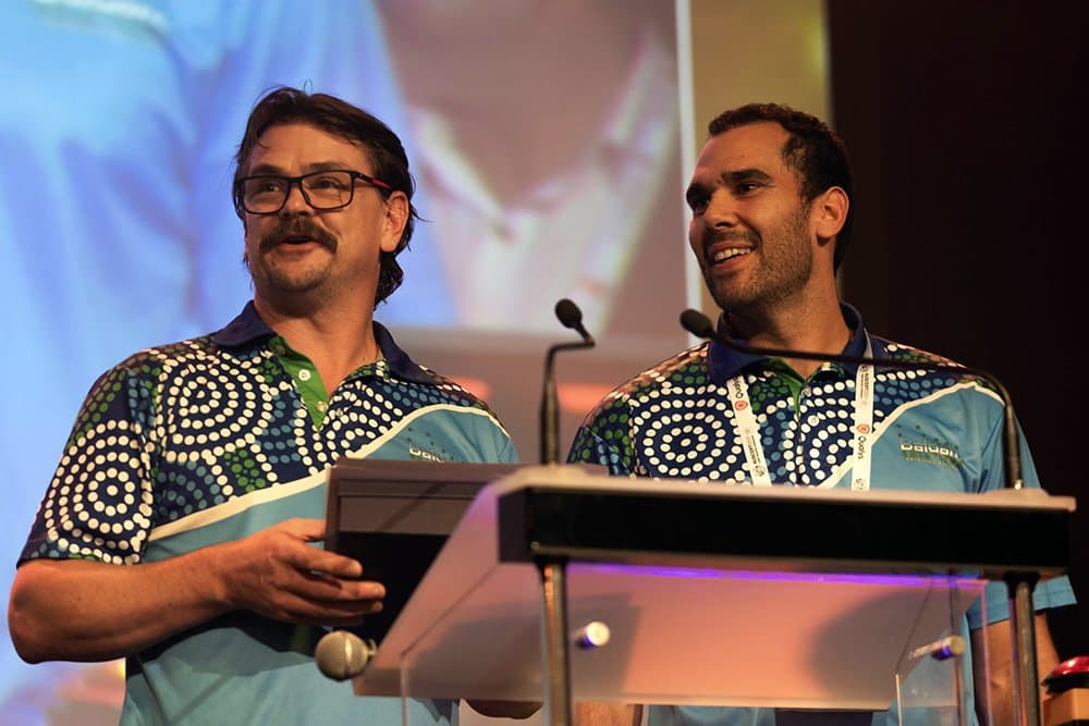Baidam Co-Founders Phillip Jenkinson and Jack Reis on stage at AusSERT 2021 to receive the inaugural Diversity and Inclusion Champion award